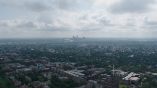 PVED01_153 - 4K stock footage aerial video fly over Carrollton College and suburbs to approach Downtown New Orleans, Louisiana