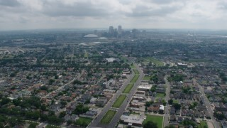 PVED01_155 - 4K stock footage aerial video tilt from Garden District suburbs to reveal Downtown New Orleans skyline, Louisiana