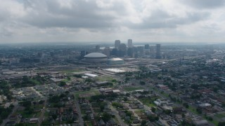 PVED01_156 - 4K stock footage aerial video tilt from Garden District homes to reveal Downtown New Orleans skyline, Louisiana