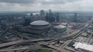 PVED01_157 - 4K stock footage aerial video approach the Superdome and Downtown New Orleans from the Garden District, Louisiana