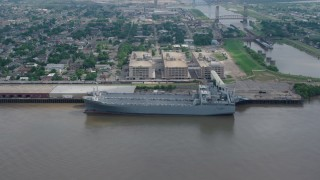 PVED01_161 - 4K stock footage aerial video orbit two Naval Reserve warships docked on the Mississippi River in Bywater, New Orleans, Louisiana
