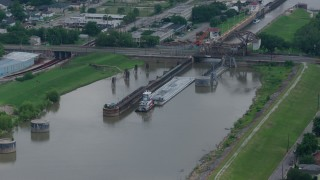 PVED01_162 - 4K stock footage aerial video approach a barge beneath a bridge on Industrial Canal in New Orleans, Louisiana