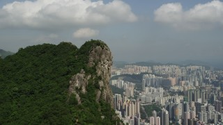 SS01_0002 - 5K stock footage aerial video flyby rocky peak in Kowloon with a view of apartment buildings in Hong Kong, China