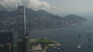 SS01_0004 - 5K stock footage aerial video approach International Commerce Centre in Kowloon and Hong Kong Island in China
