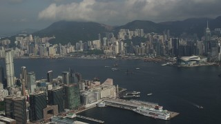 SS01_0007 - 5K stock footage aerial video pan across Hong Kong Island high-rises and waterfront office buildings in Kowloon, Hong Kong, China
