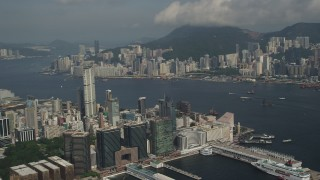 SS01_0008 - 5K stock footage aerial video of Kowloon waterfront office buildings and Victoria Harbor in Hong Kong, China