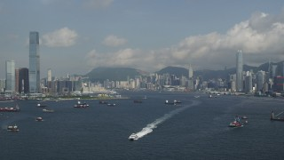 SS01_0009 - 5K stock footage aerial video approach skyscrapers and waterfront buildings in Kowloon and Hong Kong Island, China