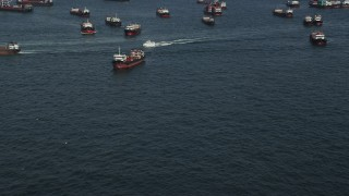 SS01_0012 - 5K stock footage aerial video approach a ferry sailing by cargo ships on Victoria Harbor in Hong Kong, China