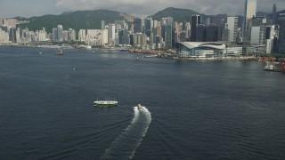 SS01_0015 - 5K stock footage aerial video of Hong Kong Island shoreline seen from Victoria Harbor in Hong Kong, China