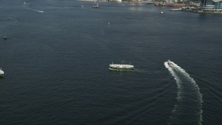 SS01_0016 - 5K stock footage aerial video approach and tilt to two ferries sailing Victoria Harbor in Hong Kong, China
