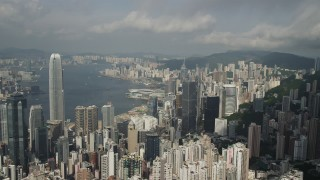 SS01_0037 - 5K stock footage aerial video fly over high-rises to approach skyscrapers on the shore of Hong Kong Island, China