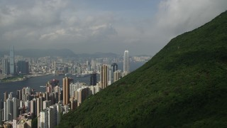 SS01_0039 - 5K stock footage aerial video approach skyscrapers on Hong Kong Island from green mountains, China