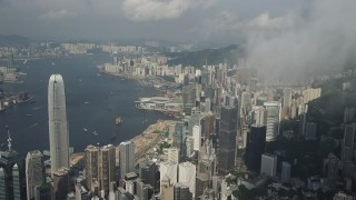 SS01_0042 - 5K stock footage aerial video approach skyscrapers, convention center and harbor on Hong Kong Island, China
