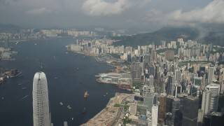 SS01_0043 - 5K stock footage aerial video of waterfront skyscrapers and convention center along Victoria Harbor on Hong Kong Island, China