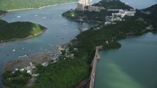 SS01_0059 - 5K stock footage aerial video fly over reservoir and tilt to reveal apartment buildings overlooking harbor on Hong Kong Island, China