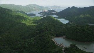SS01_0061 - 5K stock footage aerial video of green forest around reservoirs on Hong Kong Island, China