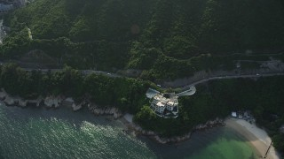 SS01_0072 - 5K stock footage aerial video fly over cove and coastal road on Hong Kong Island, China