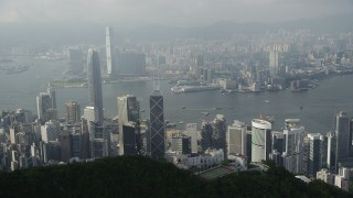 SS01_0082 - 5K stock footage aerial video fly over peak to reveal harbor and skyscrapers on Hong Kong Island and Kowloon, China