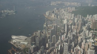 SS01_0084 - 5K stock footage aerial video pan across harbor and convention center in Hong Kong, China