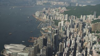 SS01_0085 - 5K stock footage aerial video of skyscrapers on the shore of Victoria Harbor on Hong Kong Island, China