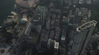 SS01_0091 - 5K stock footage aerial video tilt from skyscraper to reveal waterfront concert hall and museum in Kowloon, Hong Kong