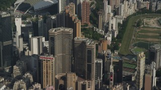SS01_0100 - 5K stock footage aerial video reverse view of Times Square Towers and reveal race track on Hong Kong Island, China