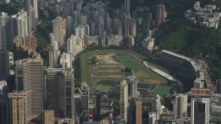 SS01_0101 - 5K stock footage aerial video of race track on Hong Kong Island ringed by skyscrapers in China
