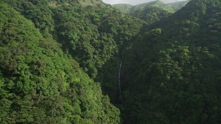 SS01_0108 - 5K stock footage aerial video approach a waterfall in the mountains with forest on Hong Kong Island, China