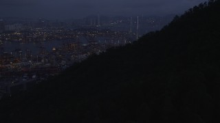 SS01_0111 - 5K stock footage aerial video tilt to reveal the Port of Hong Kong and the Stonecutters Bridge at night, China