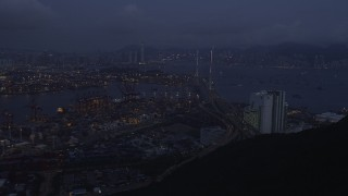 SS01_0112 - 5K stock footage aerial video approach the Port of Hong Kong and the Stonecutters Bridge at night, China
