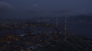 SS01_0114 - 5K stock footage aerial video of flying over the Port of Hong Kong to approach the Stonecutters Bridge at night, China