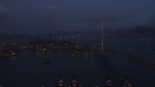 SS01_0116 - 5K stock footage aerial video of flying by Stonecutters Bridge to approach part of the Port of Hong Kong at night in China