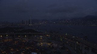 SS01_0119 - 5K stock footage aerial video fly over Port of Hong Kong to approach Kowloon and Hong Kong Island at night, China