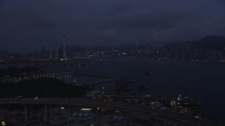 SS01_0120 - 5K stock footage aerial video approach Kowloon and Hong Kong Island skylines from the Port of Hong Kong at night, China