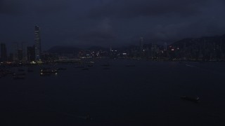 SS01_0123 - 5K stock footage aerial video of skylines of Kowloon and Hong Kong Island at night, China