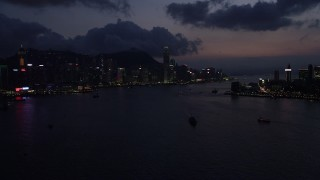 SS01_0139 - 5K stock footage aerial video of Hong Kong Island skyline and Victoria Harbor at night, China