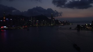 SS01_0140 - 5K stock footage aerial video of approaching Hong Kong Island and Victoria Harbor at nighttime, China