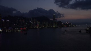 SS01_0141 - 5K stock footage aerial video skyline of Hong Kong Island, Victoria Harbor at nighttime in China