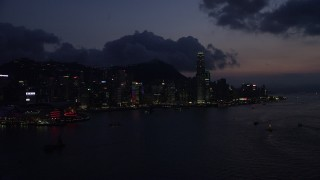 SS01_0142 - 5K stock footage aerial video waterfront skyline of Hong Kong Island and Victoria Harbor at night, China