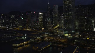 SS01_0149 - 5K stock footage aerial video flyby piers and skyscrapers on Hong Kong Island at night, China