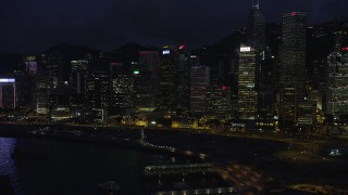 SS01_0150 - 5K stock footage aerial video flyby colorful lights on waterfront Hong Kong Island skyscrapers at night in China