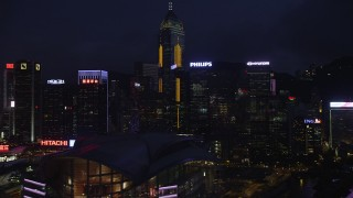 SS01_0153 - 5K stock footage aerial video of Hong Kong Island skyscrapers, office buildings and convention center at night, China