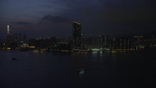 SS01_0156 - 5K stock footage aerial video approach Harbourfront Landmark skyscrapers in Kowloon, Hong Kong at night, China