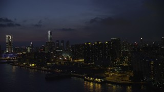 SS01_0159 - 5K stock footage aerial video of waterfront apartment buildings overlooking the harbor at night in Kowloon, Hong Kong, China