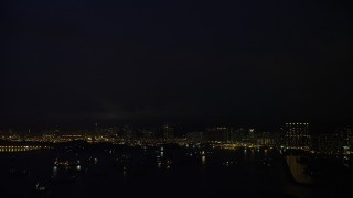 SS01_0165 - 5K stock footage aerial video of lightning flashes over apartment buildings at night in Kowloon, Hong Kong, China