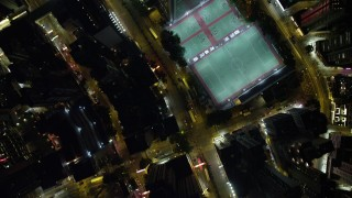 SS01_0174 - 5K stock footage aerial video bird's eye view of city streets at night on Hong Kong Island, China