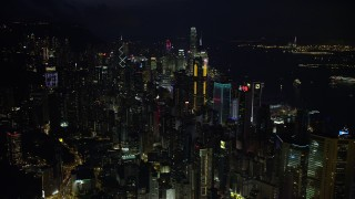 SS01_0177 - 5K stock footage aerial video approach and pan across tall towers of Hong Kong Island at night, China