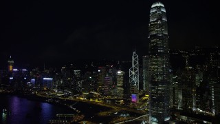 SS01_0186 - 5K stock footage aerial video flyby International Finance Centre and waterfront towers at night on Hong Kong Island, China