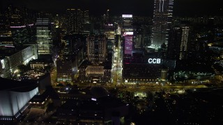 SS01_0190 - 5K stock footage aerial video approach skyscrapers and office buildings on Nathan Road at night in Kowloon, Hong Kong, China