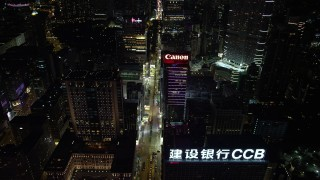 SS01_0191 - 5K stock footage aerial video approach Nathan Road and office buildings at night in Kowloon, Hong Kong, China